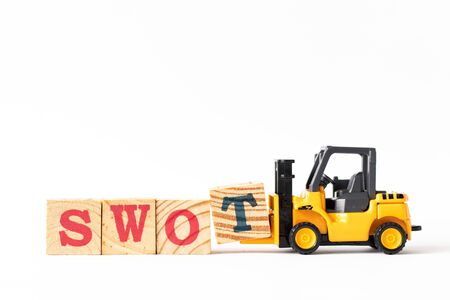 Toy forklift hold wood letter block t to complete word swot (abbreviation of strength, weakness, opportunities, threats) on white background