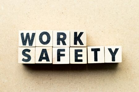 Letter block in word work safety on wood background Stok Fotoğraf