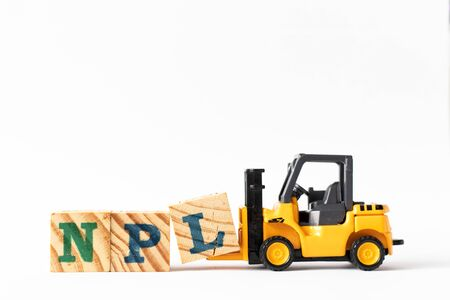 Toy forklift hold wood letter block L to complete word NPL (Abbbreviation of Non Performing Loan, Non-Patent Literature) on white background