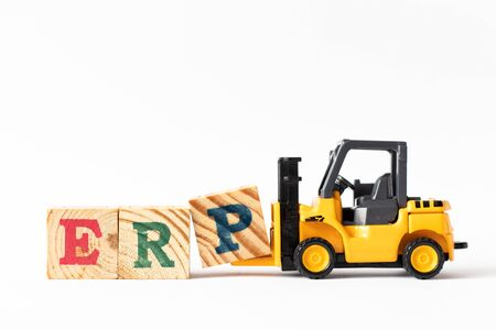 Toy forklift hold wood letter block P to complete word ERP (Abbreviation of Enterprise Resource Planning) on white background Stock Photo