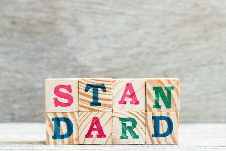 Letter block in word standard on wood background