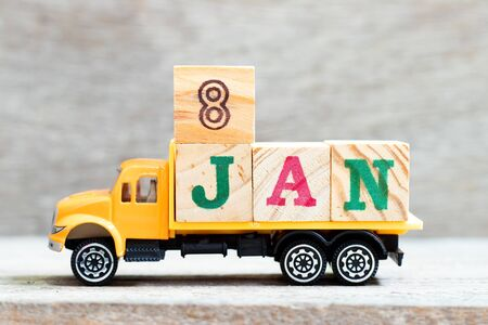 Truck hold letter block in word 8jan on wood background (Concept for date 8 month January)