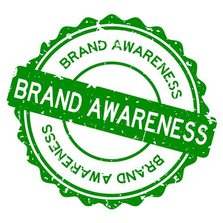 Grunge green brand awareness word round rubber seal stamp on white background