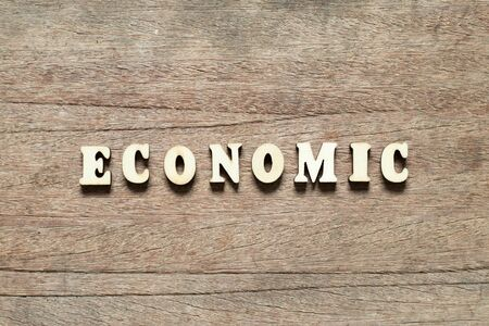 Letter block in word economic on wood background