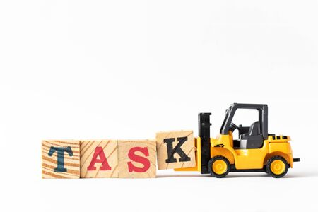Toy forklift hold wood letter block k to complete word task on white background
