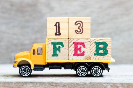 Truck hold letter block in word 13feb on wood background (Concept for date 13 month February)