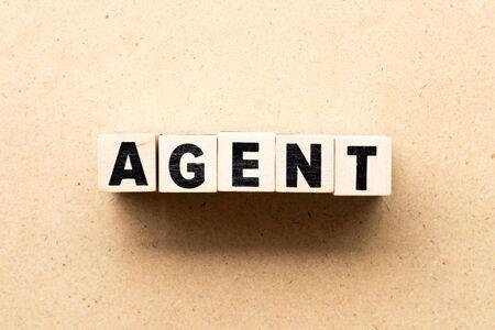 Letter block in word agent on wood background Banco de Imagens