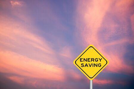 Yellow transportation sing with word energy saving on violet sky background Reklamní fotografie