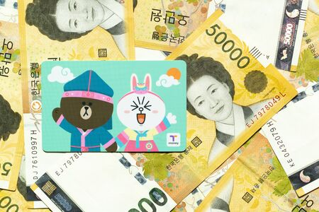 Bangkok, Thailand - Nov 15, 2019  : T money card with line cartoon character on Korean 50000 won banknote.