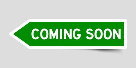Green color arrow sticker with word coming soon on gray background