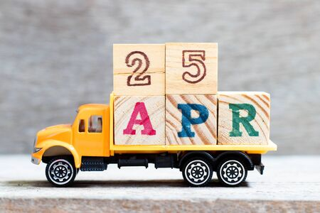 Truck hold letter block in word 25apr on wood background (Concept for date 25 month April)