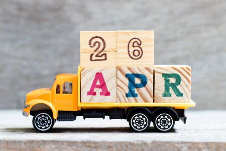 Truck hold letter block in word 26apr on wood background (Concept for date 26 month April)