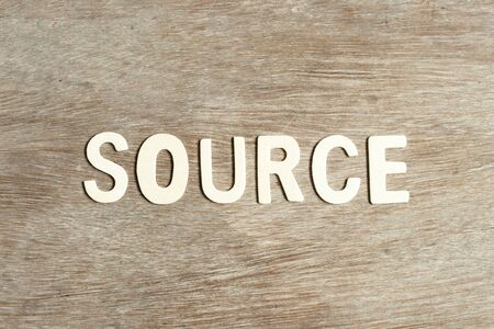 Alphabet letter in word source on wood background