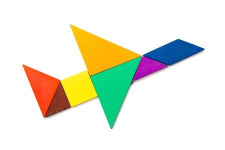 Color wood tangram puzzle in airplane shape on white background Stock Photo