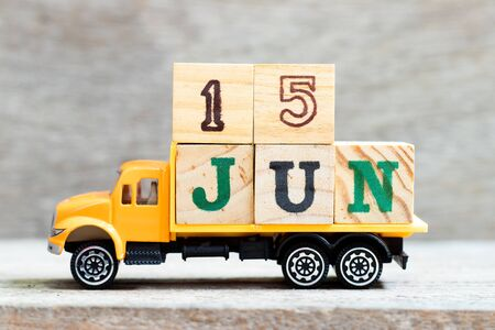 Truck hold letter block in word 15jun on wood background (Concept for date 15 month June)
