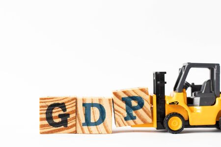 Toy forklift hold wood letter block P to complete word GDP (Gross domestic product or Good distribution practice) on white background