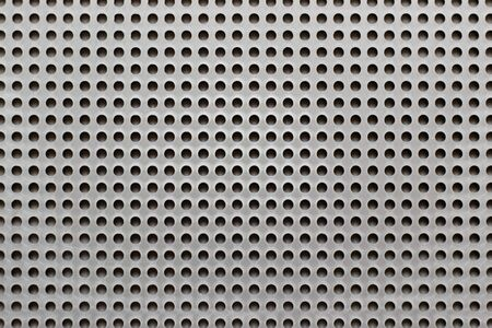 Blank color plastic pegboard texture background with copy space