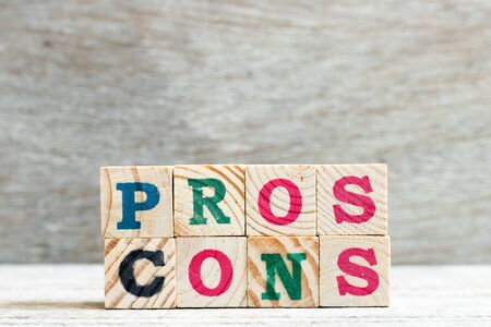 Letter block in word pros cons on wood background