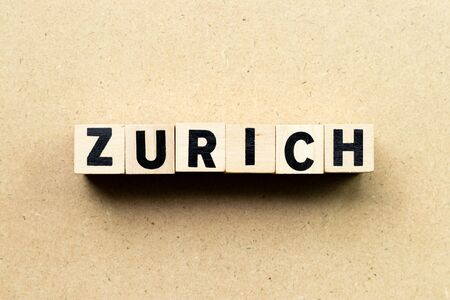 Letter block in word Zurich on wood background