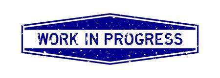 Grunge blue work in progress word hexagon rubber seal stamp on white background
