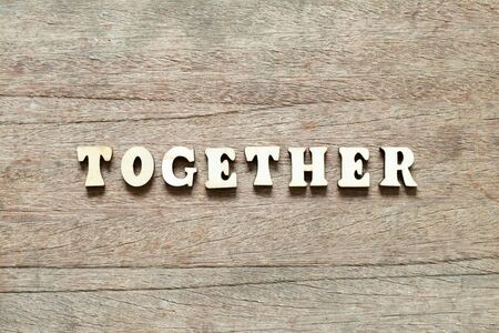 Letter block in word together on wood background