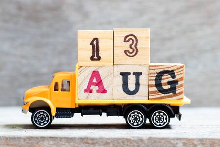 Truck hold letter block in word 13aug on wood background (Concept for date 13 month August)