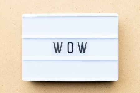 White lightbox with word wow on wood background Stock Photo