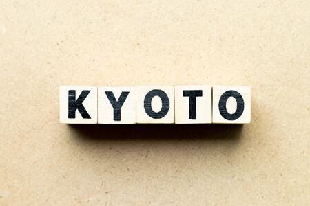 Letter block in word Kyoto on wood background