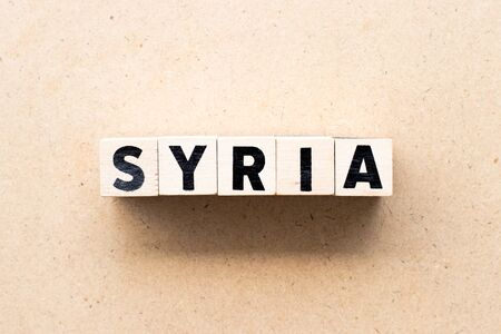 Letter block in word syria on wood background