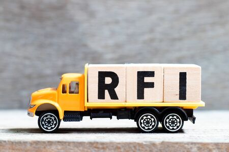 Truck hold letter block in word RFI (Abbreviation of request for information) on wood background