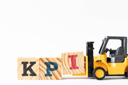 Toy forklift hold wood letter block I to complete word KPI (Abbreviation of Key performance indicator) on white background