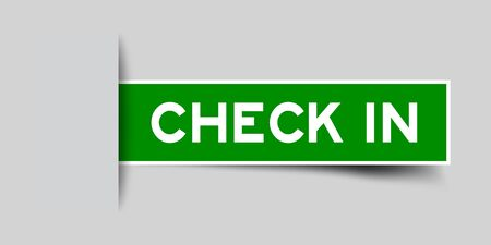 Inserted green color sticker label with word check in on gray background