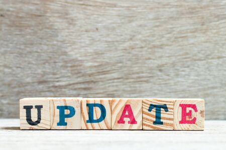 Alphabet letter in word update on wood background
