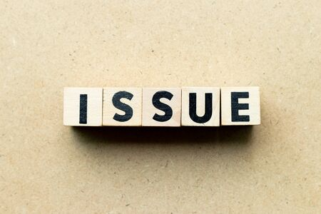 Letter block in word issue on wood background