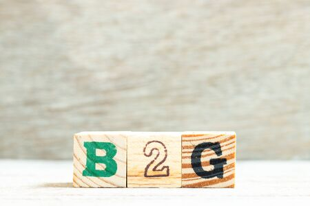 Alphabet letter in word b2g (abbreviation of business to government) on wood background Reklamní fotografie