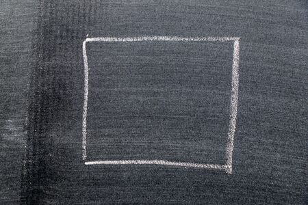 White color chalk hand drawing in square shape on black board background Standard-Bild