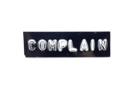 Embossed letter in word complain in black banner on white background