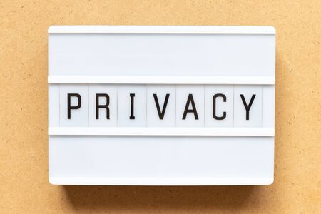 Lightbox with word privacy on wood background
