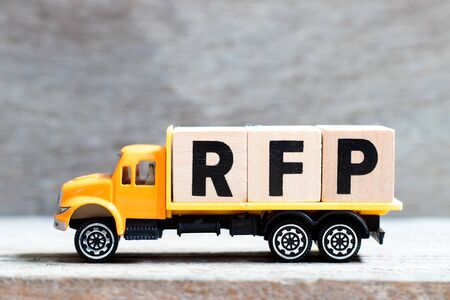 Truck hold letter block in word RFP (Abbreviation of request for proposal) on wood background