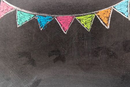 Colorful chalk drawing in hanging party flag shape on blackboard background