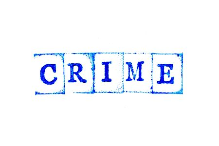Blue ink of rubber stamp in word crime on white paper background