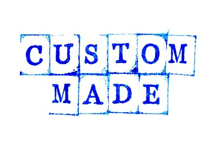 Blue ink of rubber stamp in word custom made on white paper background