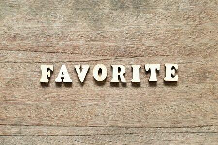 Alphabet letter block in word favorite on wood background