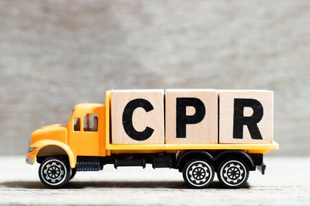 Truck hold letter block in word CPR (abbreviation of Cardiopulmonary resuscitation) on wood background
