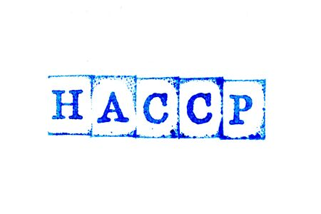 Blue ink of rubber stamp in word HACCP (Hazard Analysis Critical Control Points) on white paper background Stock Photo