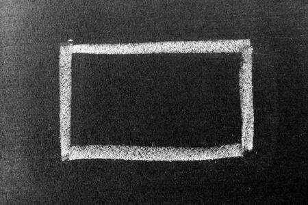 White chalk hand drawing in square or banner shape on black board background