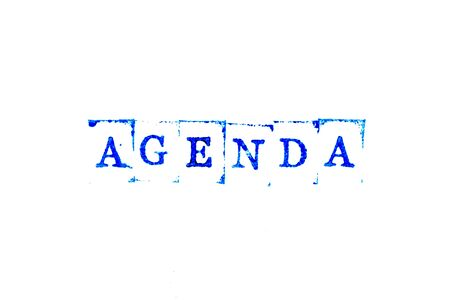 Blue ink of rubber stamp in word agenda on white paper background Archivio Fotografico