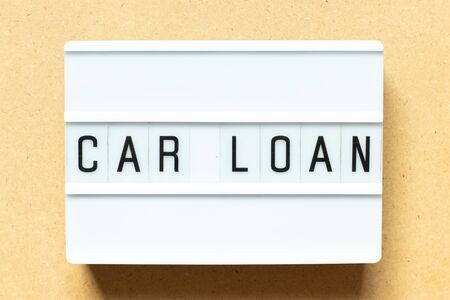 Lightbox with word car loan on wood background