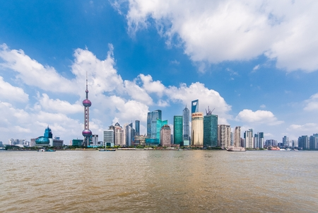 pudong district: SHANGHAI-JUNE 2, 2012. Huangpu River and Pudong district seen from Bund. The Pudong district houses Lujiazui Finance and Trade Zone and the Shanghai Stock Exchange, it is China\\\\\\\\\\\\\\\\