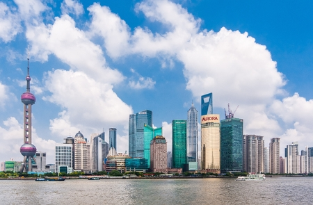 pudong district: SHANGHAI-JUNE 2, 2012. Huangpu River and Pudong district seen from Bund. The Pudong district houses Lujiazui Finance and Trade Zone and the Shanghai Stock Exchange, it is China